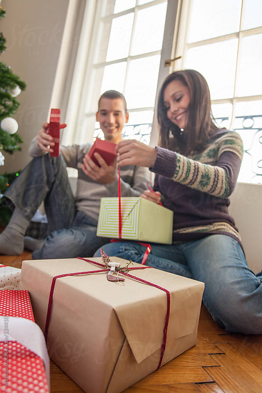 Couple Opening Christmas Gifts by Mosuno for Stocksy United