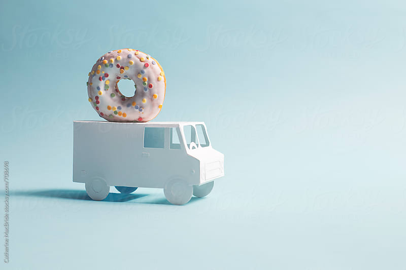 Delivering donuts/doughnuts by Catherine MacBride for Stocksy United