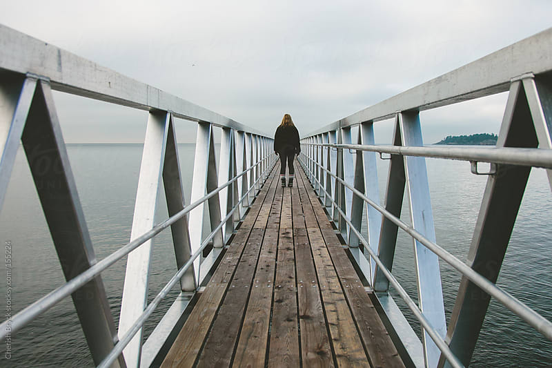 Way down on the pier. by Cherish Bryck for Stocksy United