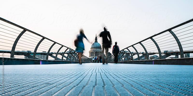 Couple walking on Millenium Bridge against St Paul - London by GIC for Stocksy United