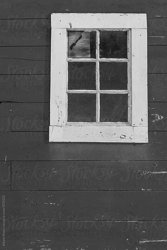 Broken window on a weathered wall by Adam Nixon for Stocksy United