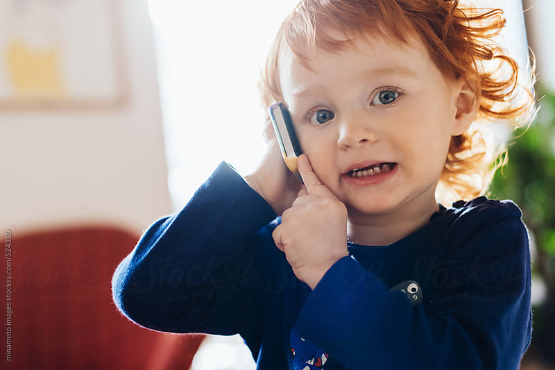 Little Redhead Boy With Smartphone by minamoto images for Stocksy United
