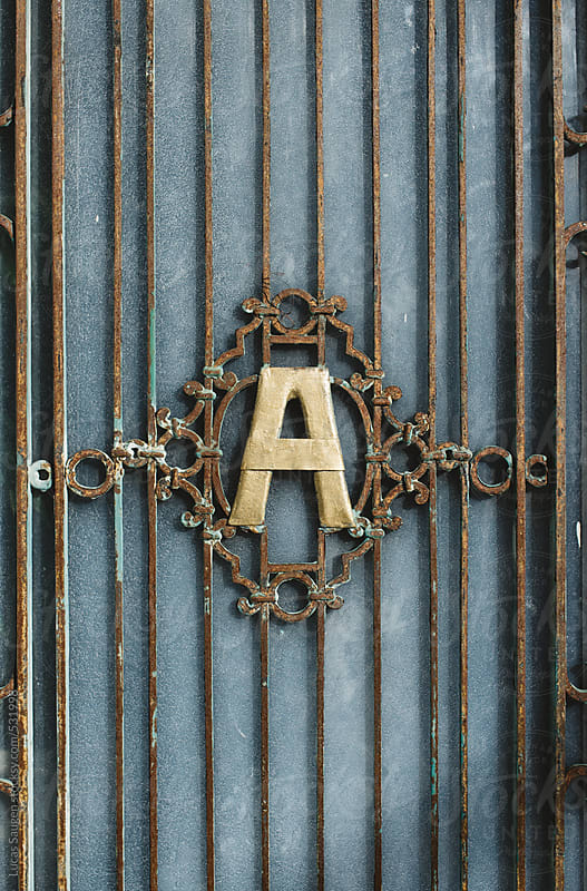 A big letter A in a vintage cast iron grate. by Lucas Saugen for Stocksy United