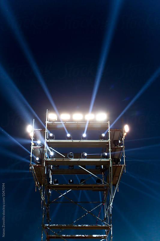 Concert spot lighting over dark background by Nasos Zovoilis for Stocksy United