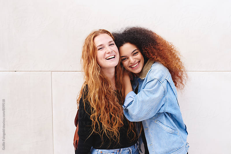 Two young girlfriends having fun together by Guille Faingold for Stocksy United