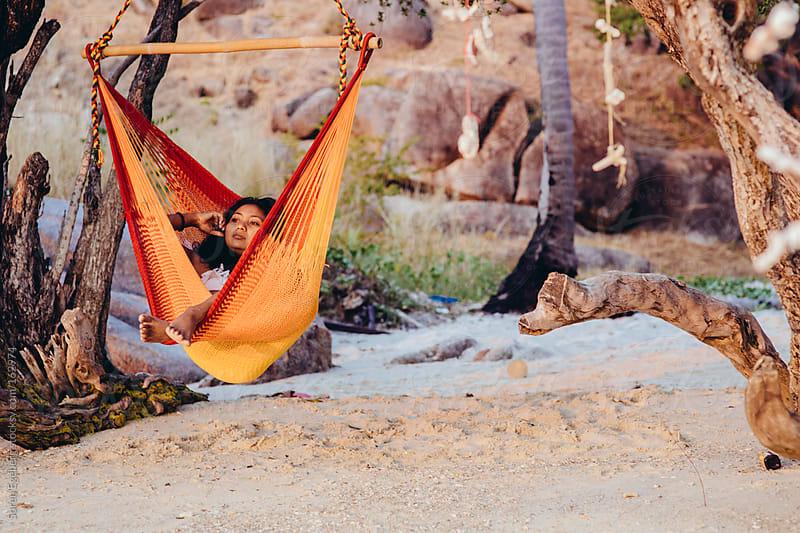 Beautifull asian girl relax in hammock by Soren Egeberg for Stocksy United