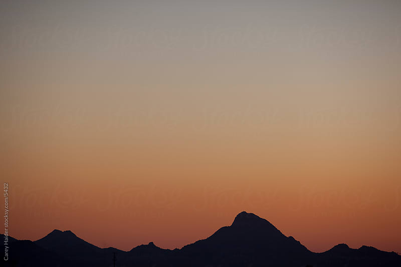 Sunset Over A mountain Range by Carey Haider for Stocksy United