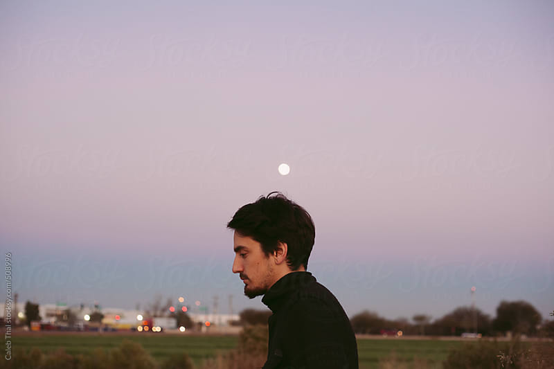A Man and the Moon by Caleb Thal for Stocksy United