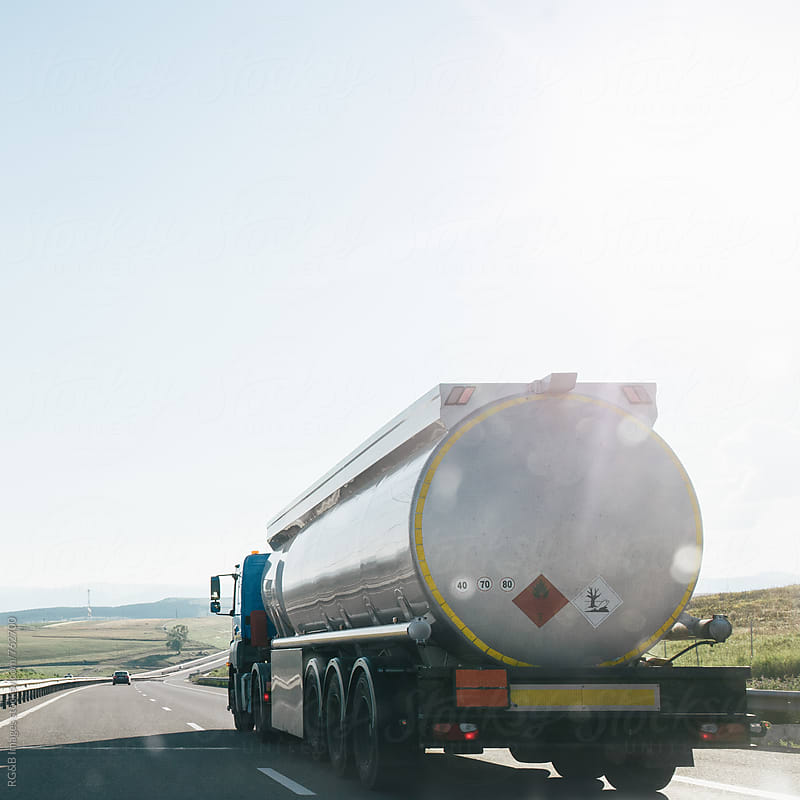 Tanker truck driving on the highway in the sunlight by RG&B Images for Stocksy United