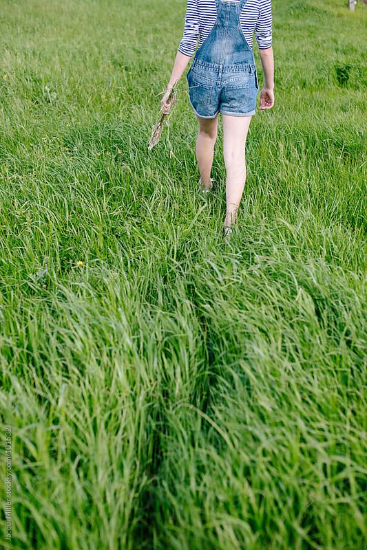 Walking in green fields by Jacqui Miller for Stocksy United