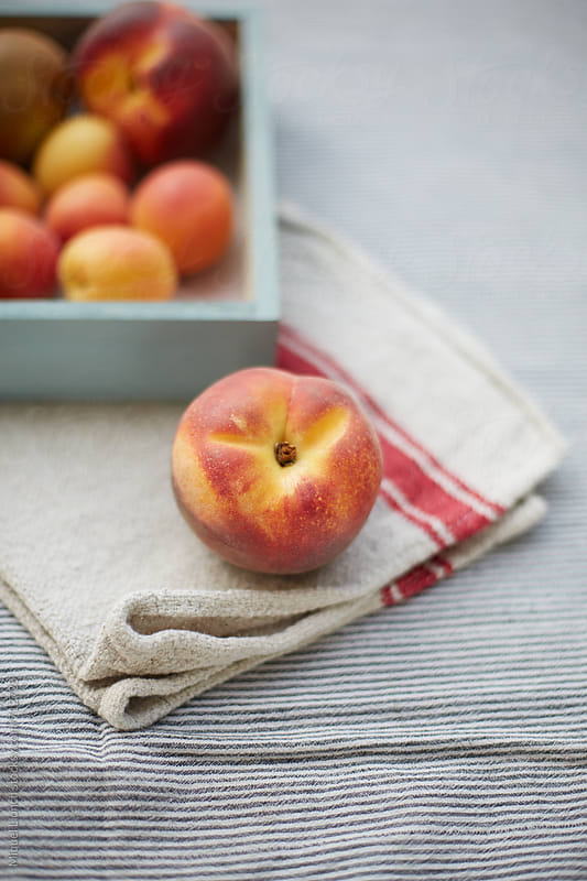 Beautiful peach and other fresh fruit by Miquel Llonch for Stocksy United