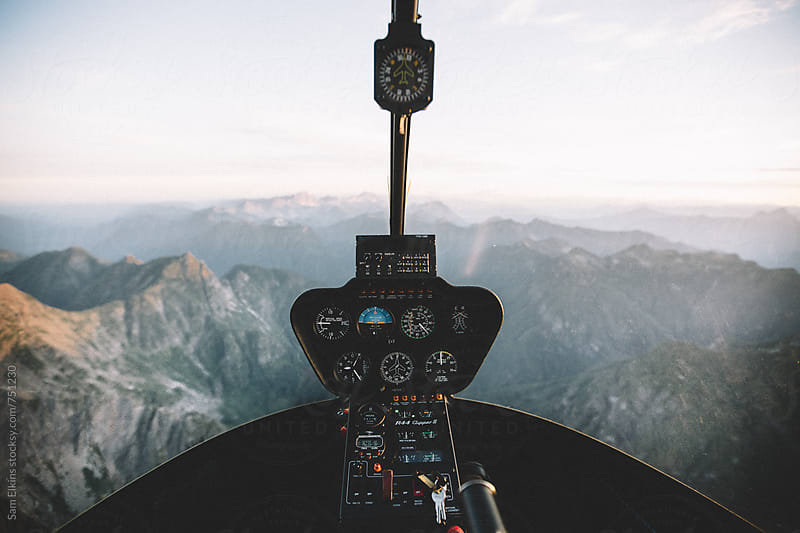 Helicopter Ride 8000ft by Sam Elkins for Stocksy United