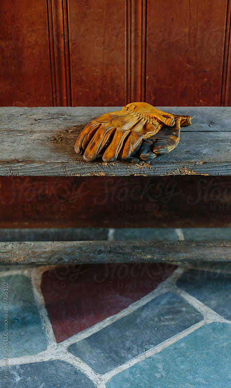 Work Gloves on Bench by Raymond Forbes LLC for Stocksy United
