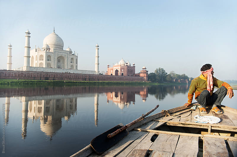 A boatman near the Taj Mahal, Agra by Bisual Studio for Stocksy United