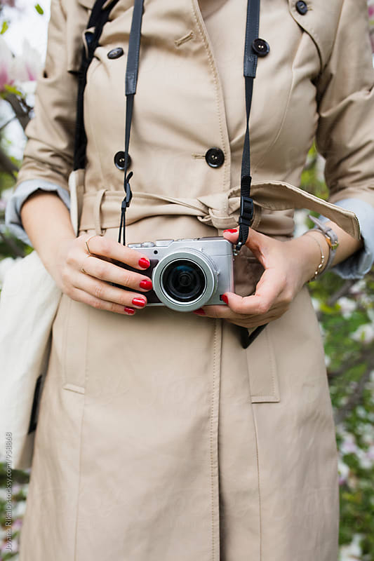 Young woman holding a camera by Jovana Rikalo for Stocksy United
