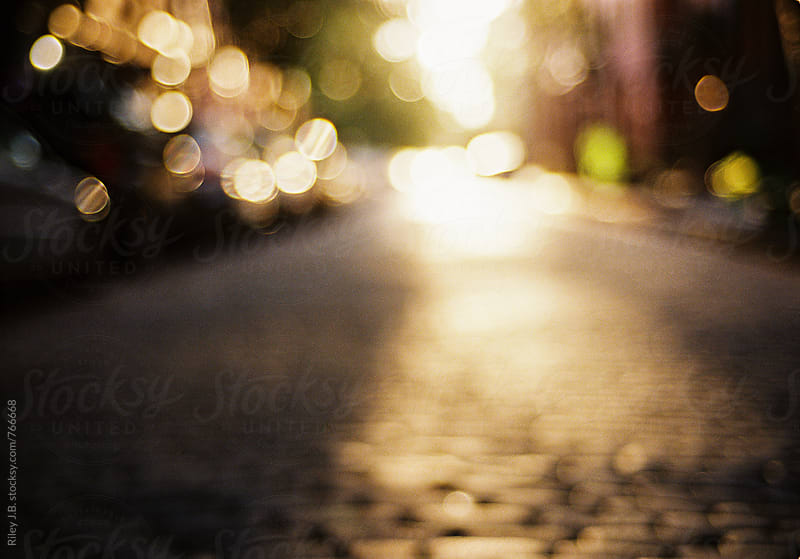 Out of focus cobblestone street. by Riley J.B. for Stocksy United