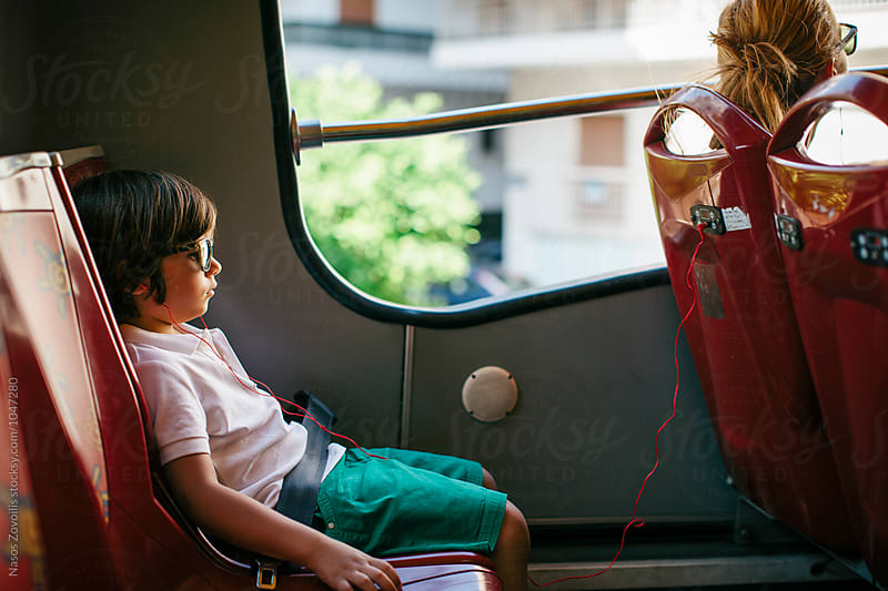 5 year old boy in a bus by Nasos Zovoilis for Stocksy United
