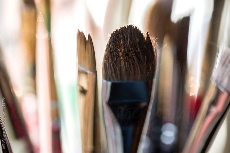 Closeup of Artist's Paintbrushes on Window Sill by Jeff Wasserman for Stocksy United