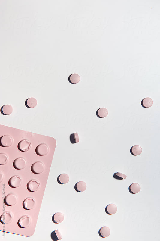 Pink blister pack with pills by Beatrix Boros for Stocksy United