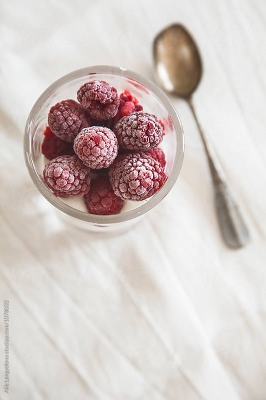 Healthy Breakfast with Yogurt and Frozen Raspberries by Alie Lengyelova for Stocksy United