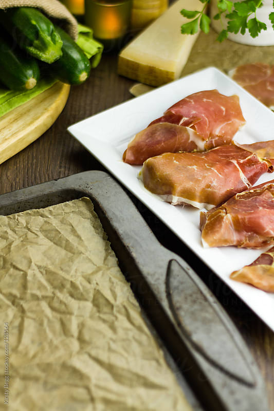 Prosciutto wrapped chicken breasts with copy space by Kirsty Begg for Stocksy United