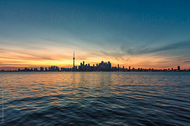 Toronto Skyline and Lake Ontario Shortly after Sunset, Canada by Tom Uhlenberg for Stocksy United