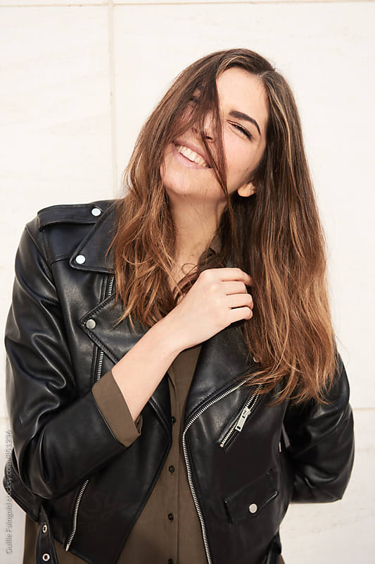 Portrait of cheerful smiling young woman  by Guille Faingold for Stocksy United
