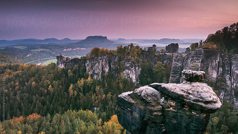 View towards the Rock Bridge at the Bastei in Saxon Switzerland by Andreas Wonisch for Stocksy United