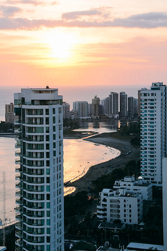 Sunset at the beach with white apartments - buildings on the foreground. Cartagena de Indias, Colombia by Alejandro Moreno de Carlos for Stocksy United