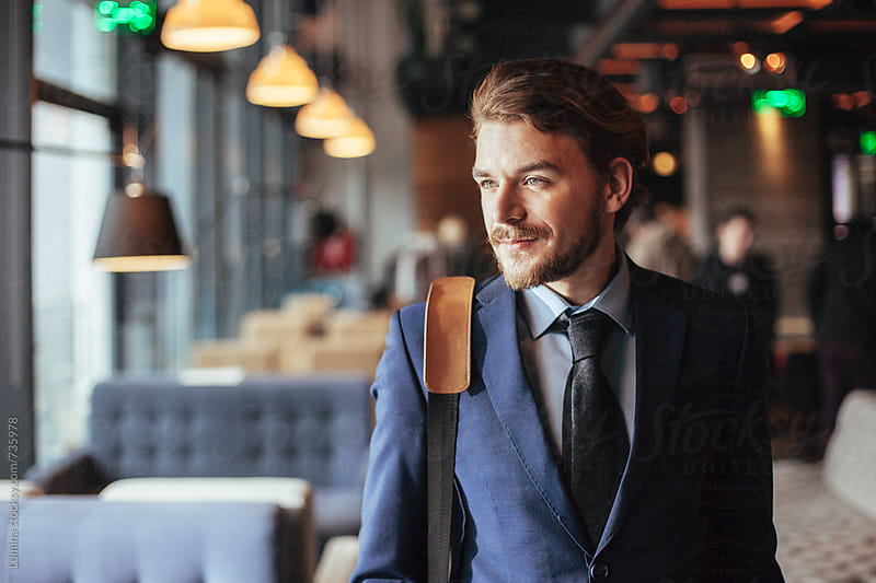 Businessman in a Bar by Lumina for Stocksy United