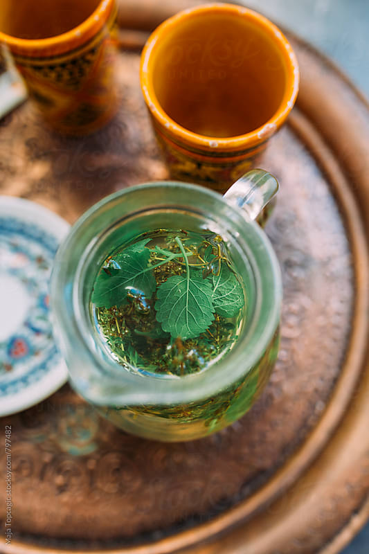 Herbal tea in a carafe by Maja Topcagic for Stocksy United