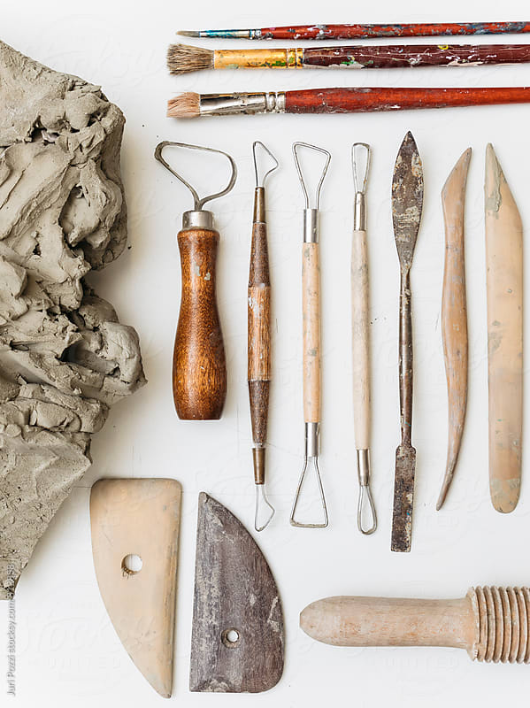 Clay with tools by Juri Pozzi for Stocksy United