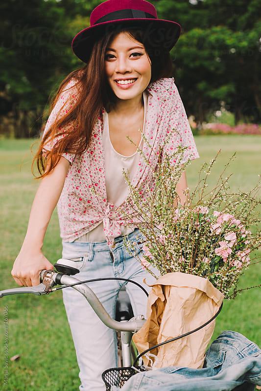 Beautiful Woman on Bicycle by Marija Savic for Stocksy United