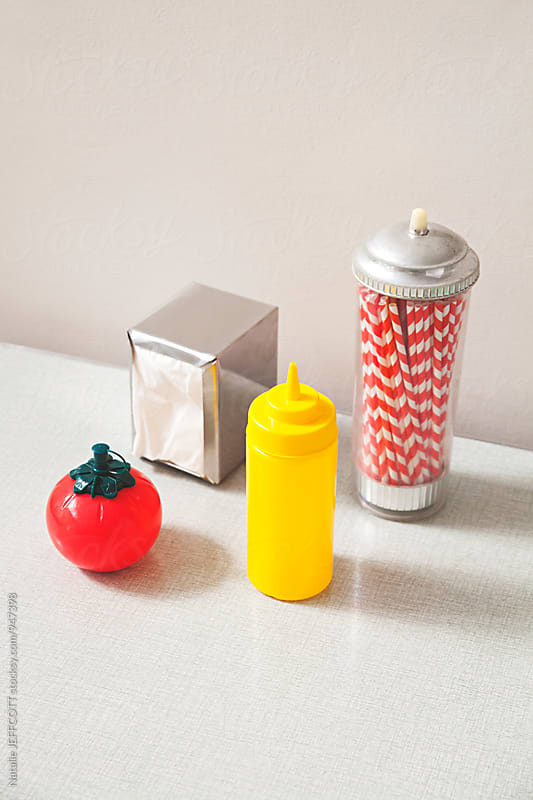 Retro tomato ketchup / sauce dispenser by Natalie JEFFCOTT for Stocksy United