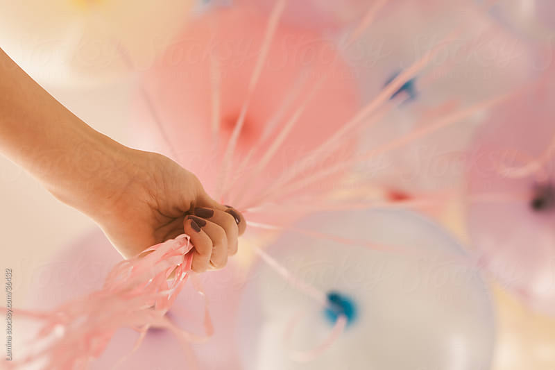 Woman Holding Balloons by Lumina for Stocksy United