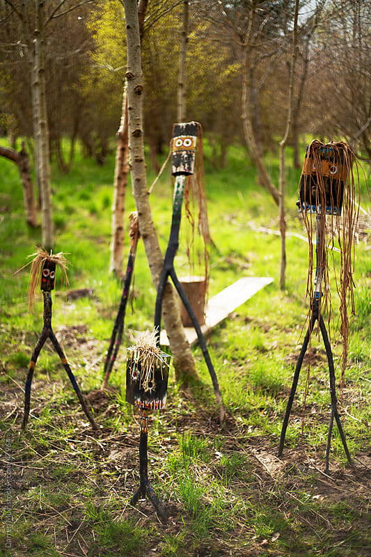 Hand carved wooden figures in woodland. by Darren Muir for Stocksy United