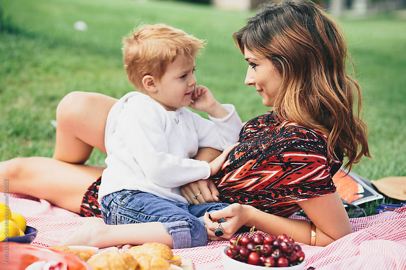 Mother and son at a family picnic in the summer by Ania Boniecka for Stocksy United