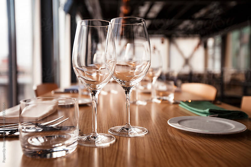 Close up shot of restaurant table setting by Paperclip Images for Stocksy United