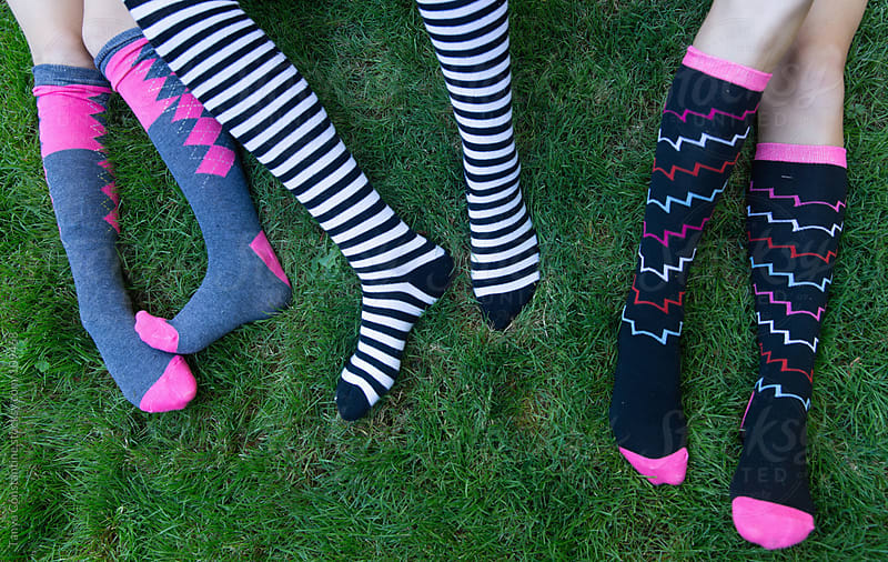 legs and feet of tween girls by Tanya Constantine for Stocksy United