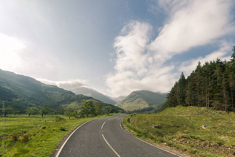 Road through a valley in the scottish highlands by Leander Nardin for Stocksy United