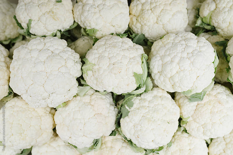 Farmers Market arrangement of fresh organic cauliflower produce by Trent Lanz for Stocksy United