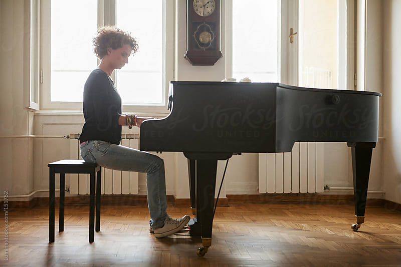 Woman Playing the Piano by Lumina for Stocksy United