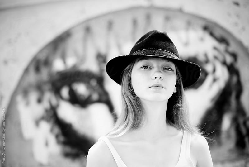 Portrait of a girl in a hat by Yury Goryanoy for Stocksy United