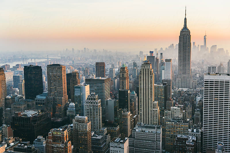 View of New York City at sunset. Cityscape by Alejandro Moreno de Carlos for Stocksy United