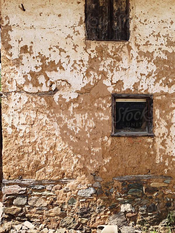 Window on rustic adobe wall  by Borislav Zhuykov for Stocksy United