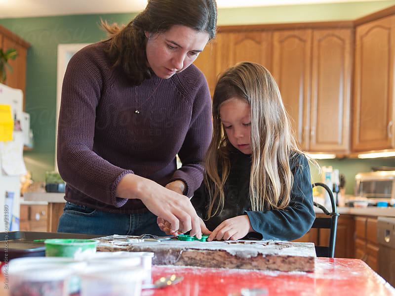 Family Baking: Mother and Child Bake Gingerbread Cookies by Brian McEntire for Stocksy United