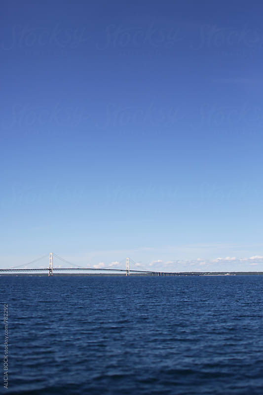 The Straits Of Mackinac And The Mackinac Bridge On A Clear Summer Day by ALICIA BOCK for Stocksy United