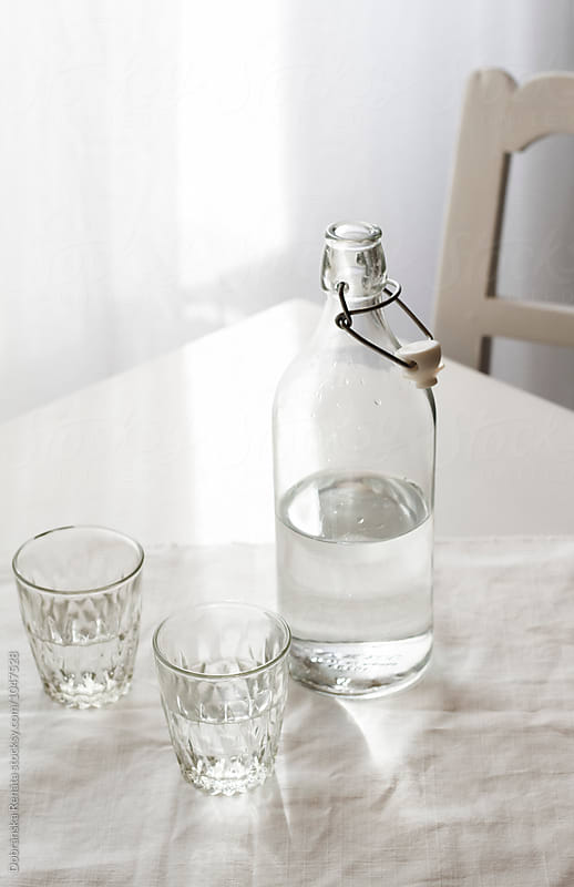 Bottle and Glass of Fresh Water by Dobránska Renáta for Stocksy United