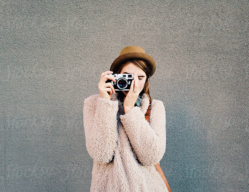 Girl with camera by Dylan M Howell Photography for Stocksy United