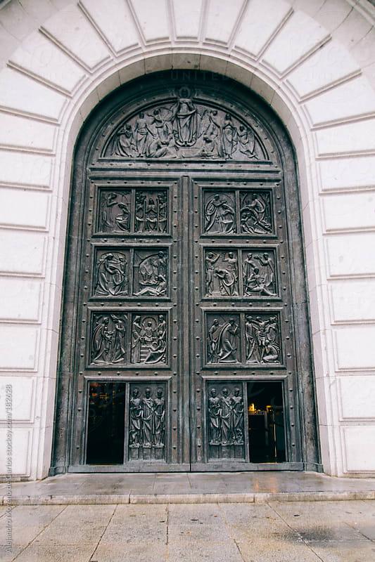 Big door with metal relief sculptures by Alejandro Moreno de Carlos for Stocksy United